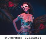 sensual tropical pin up girl... | Shutterstock . vector #323260691