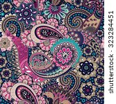 seamless paisley background ... | Shutterstock .eps vector #323284451