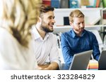 cheerful coworkers in office... | Shutterstock . vector #323284829