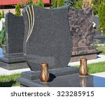 Small photo of New tombstones in the public cemetery