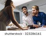 creative coworkers putting...   Shutterstock . vector #323286161