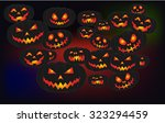 scary carved pumpkins faces for ... | Shutterstock .eps vector #323294459