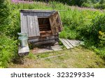 village wooden water well with...   Shutterstock . vector #323299334