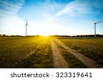 windmills on the field at... | Shutterstock . vector #323319641