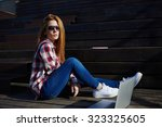 portrait of a young stylish... | Shutterstock . vector #323325605