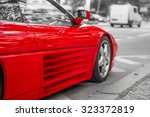 Red Sports Car On City Streets...