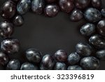 grains of red grapes arranged... | Shutterstock . vector #323396819