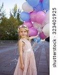 portrait of a little girl... | Shutterstock . vector #323401925