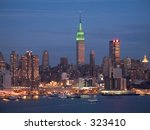 This is a colorful shot of the NY skyline just after dark. - stock photo
