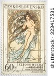 "Small photo of Moscow, Russia - October 3, 2015: A stamp printed in Czechoslovakia shows women allegory ""Painting"" by Alfons Mucha, circa 1969"