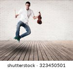 young man jumping with violin...   Shutterstock . vector #323450501