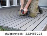 fixing composite decking with a ... | Shutterstock . vector #323459225