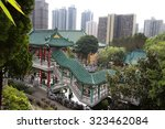 Hong Kong. The garden in the Chinese temple. The view of the landscape. Among the ponds with live fish and gurgling Brooks are  pagoda with painted roofs.