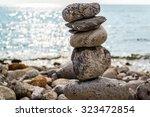 art of stone balance  piles of... | Shutterstock . vector #323472854