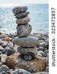 art of stone balance  piles of... | Shutterstock . vector #323472857