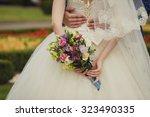 bride and groom with wedding... | Shutterstock . vector #323490335