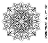 vector  flower mandala on a... | Shutterstock .eps vector #323494409