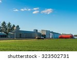 a farm with blue sky in summer... | Shutterstock . vector #323502731