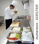 TURKEY - LARA ; profesional kitchen with a chef at work who is preparing food on 12 APRIL 2013 - stock photo