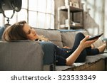 relaxed young brunette woman... | Shutterstock . vector #323533349