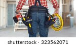 Small photo of Electrician man with drill and wire cable over construction background.