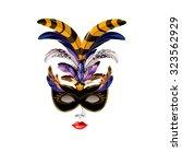 carnival venetian black mask... | Shutterstock .eps vector #323562929