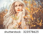 outdoor fashion photo of young... | Shutterstock . vector #323578625