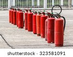 red fire extinguisher in the... | Shutterstock . vector #323581091