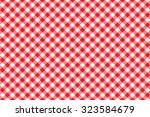 red tablecloth diagonal... | Shutterstock .eps vector #323584679