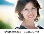 headshot portrait of happy...   Shutterstock . vector #323602745