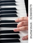 piano playing  close up on... | Shutterstock . vector #323603075