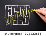 closeup hand writing way out of ... | Shutterstock . vector #323623655