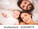 portrait of happy young parents ... | Shutterstock . vector #323658974