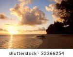 Sunset On Beach Of A Tropical...