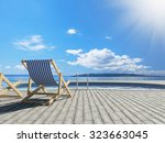 swimming pool with deckchairs... | Shutterstock . vector #323663045