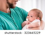 portrait of young happy father... | Shutterstock . vector #323665229