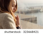beautiful sad lonely girl... | Shutterstock . vector #323668421