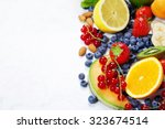 fruits on marble background.... | Shutterstock . vector #323674514