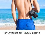 male photographer on the beach. | Shutterstock . vector #323715845