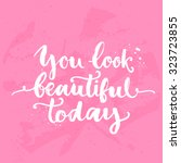 You look beautiful today. Inspirational quote, white brush calligraphy handwritten on pink background. Vector lettering for card and poster design, social media content and fashion. | Shutterstock vector #323723855