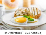 fried eggs with toasts  coffee... | Shutterstock . vector #323725535