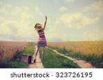 happy young woman dropped a... | Shutterstock . vector #323726195