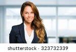 blonde businesswoman portrait   Shutterstock . vector #323732339