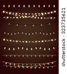 christmas lights on dark... | Shutterstock .eps vector #323735621