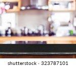 empty black marble table top...   Shutterstock . vector #323787101