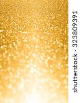abstract gold glitter sparkle... | Shutterstock . vector #323809391