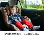 adorable baby boy in safety car ... | Shutterstock . vector #323810267