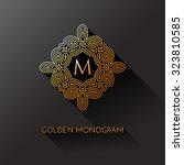 golden elegant monogram with... | Shutterstock .eps vector #323810585
