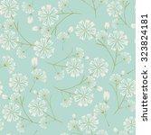 seamless daisy flower pattern... | Shutterstock .eps vector #323824181