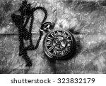 vintage pocket watch on fabric... | Shutterstock . vector #323832179